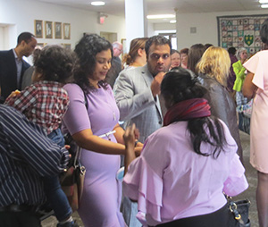 Parishioners greet one another after services