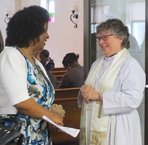Rev. Monique greets parishioners after service